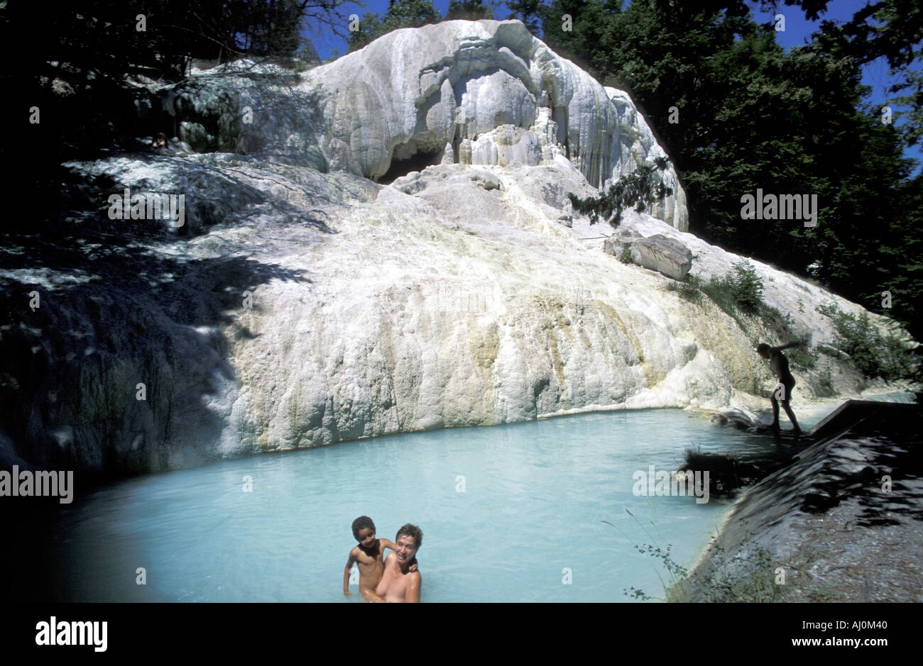 Bathers at thermal waters Fosso Bianco Bagni San Filippo Tuscany Stock Photo, Royalty Free Image ...