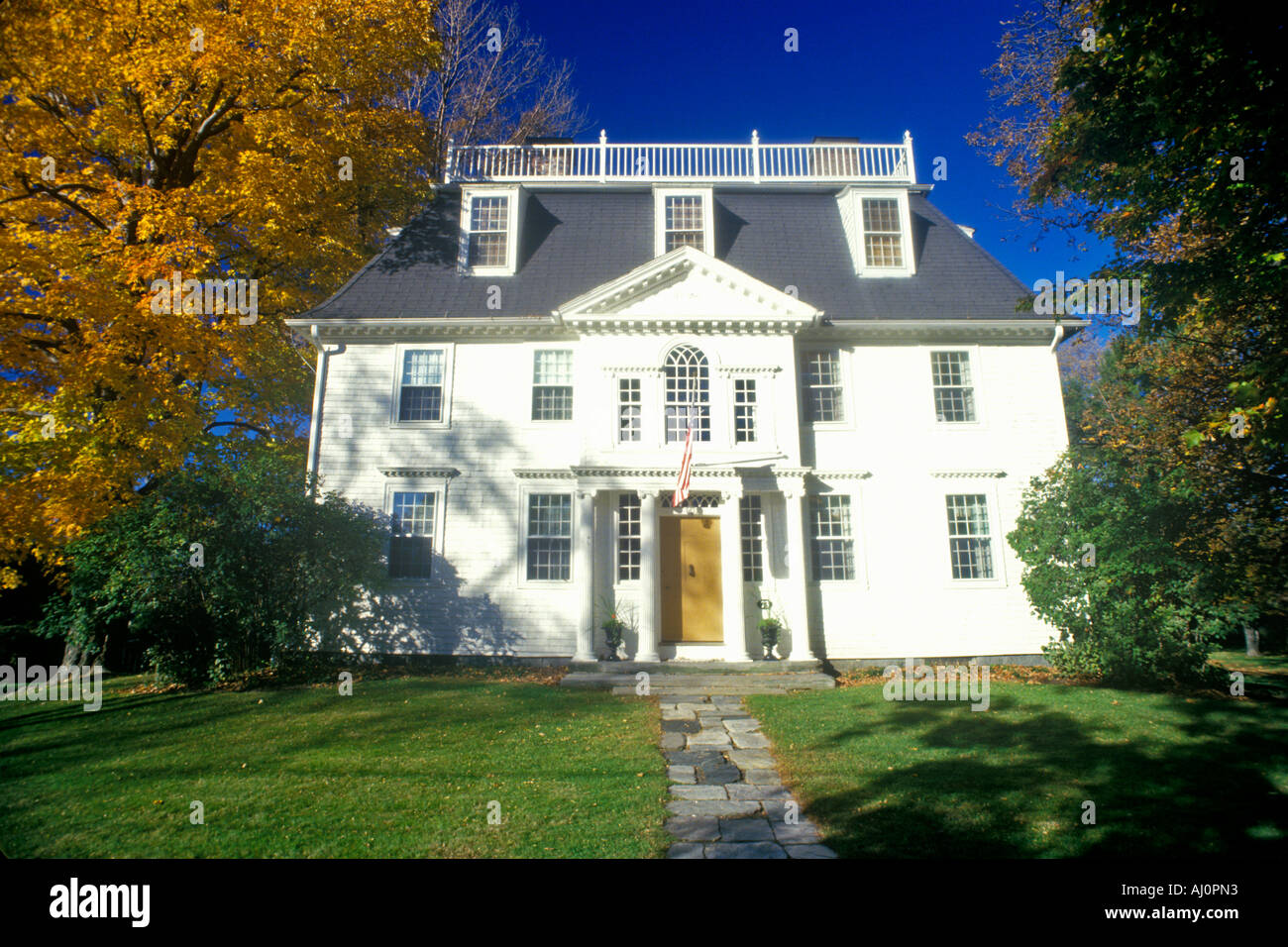 Front exterior of home with Fall colors Litchfield CT - Stock Image