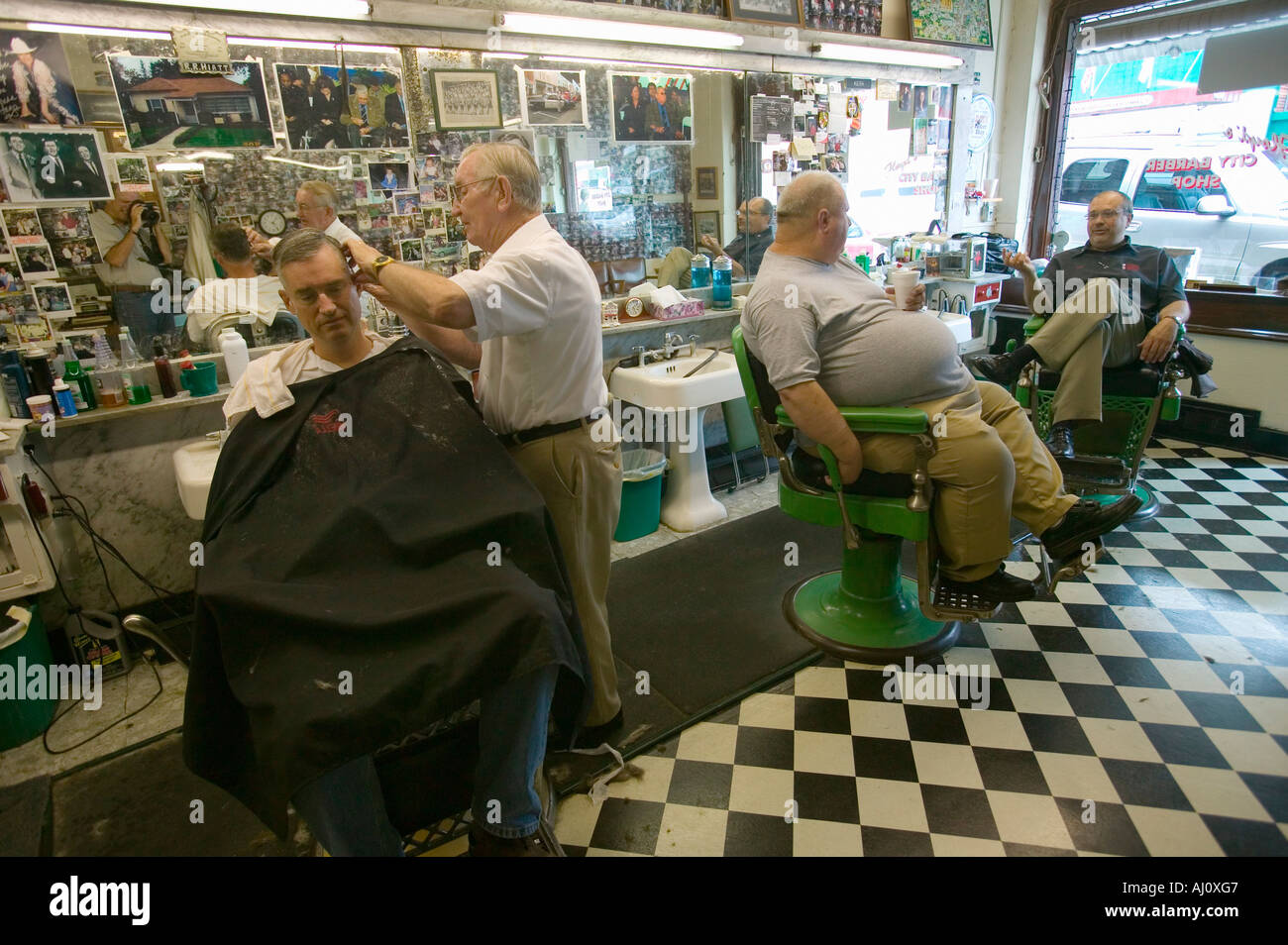 Floyd cutting hair at Floyd s City Barber Shop in Mount Airy North Carolina the town featured in Mayberry RFD and home of Andy - Stock Image