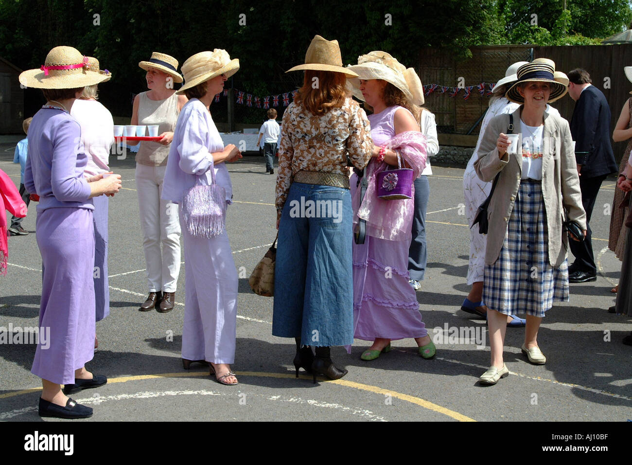 Queen Elizabeths Golden Jubilee Celebrations in a Hampshire School Playground Mums in Party Hats - Stock Image