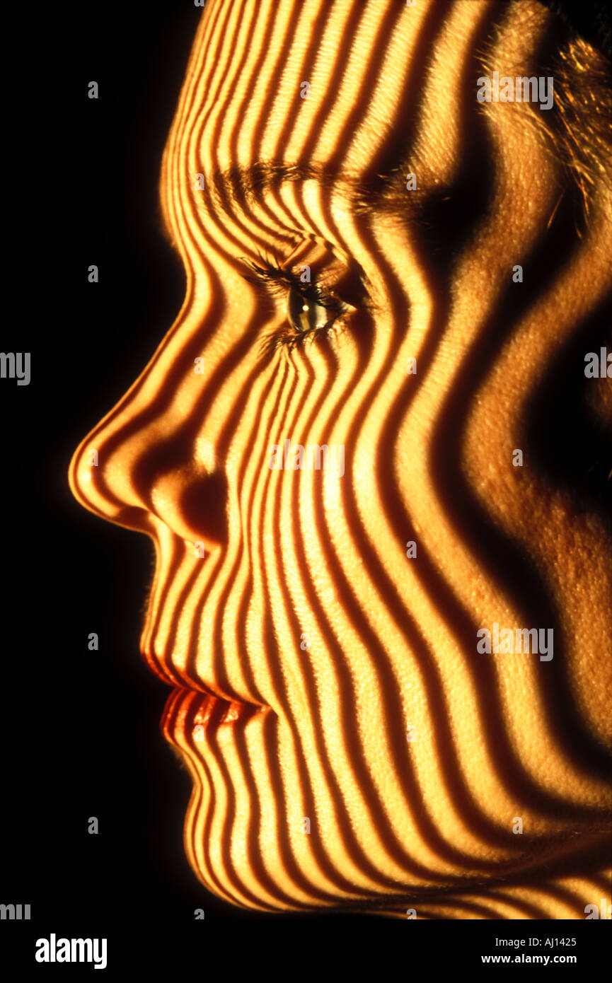 contour stripes projected on woman s face closeup - Stock Image