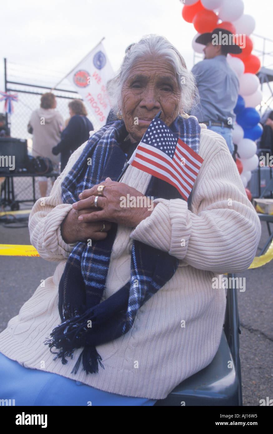 Mayan senior woman in wheel chair welcomes home USS Abraham Lincoln sailors returning from Iraq War - Stock Image