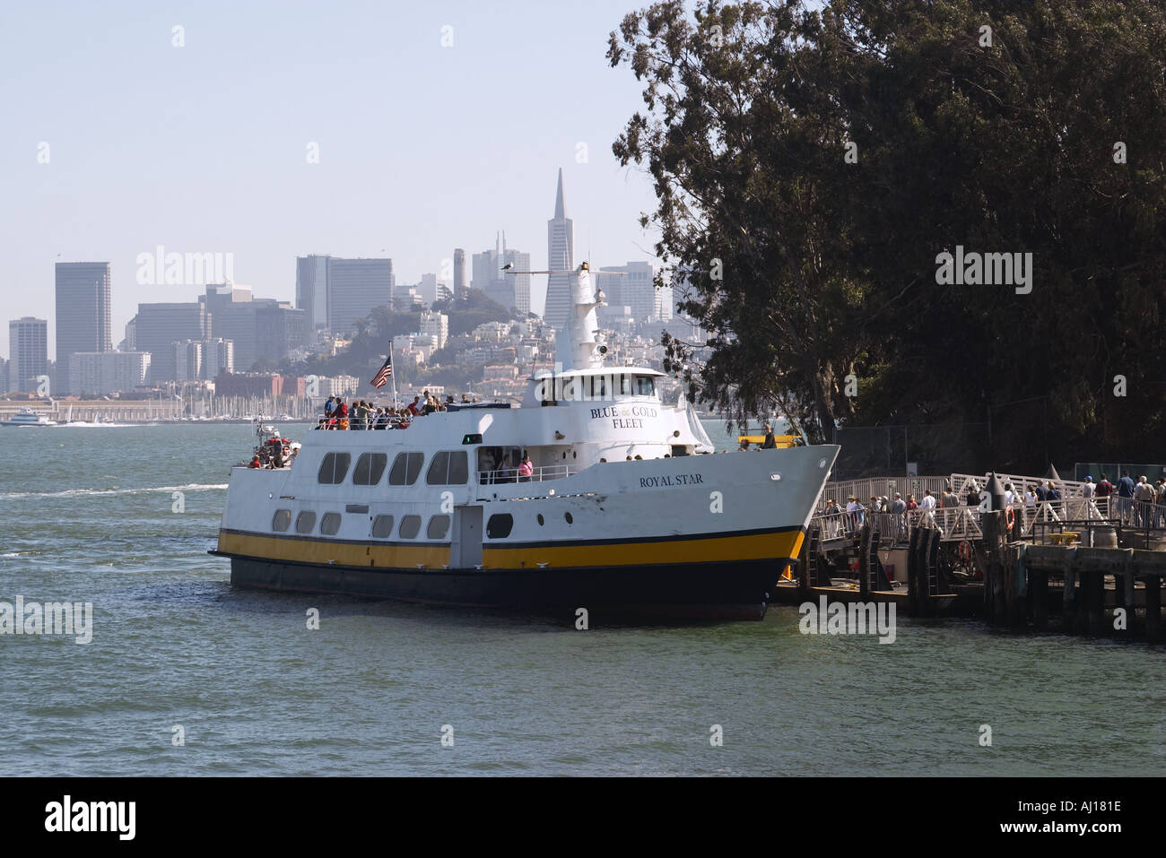 CALIFORNIA San Francisco Blue and Gold ferry boat dock at Alcatraz Island passengers go for tour of prison - Stock Image