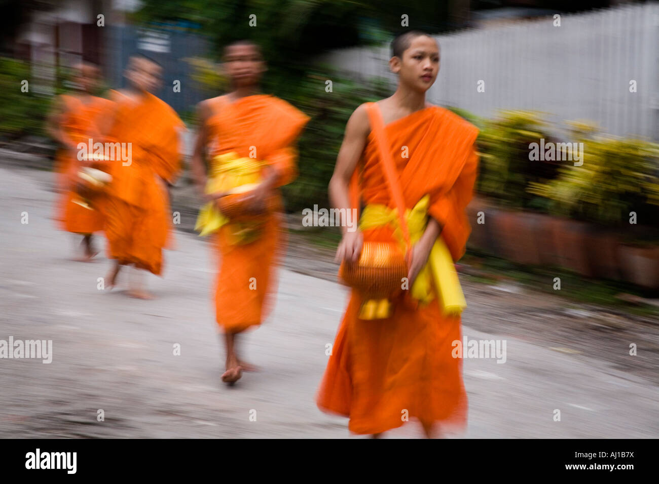 Monks on the way to collect Alms in Luang Prabang Laos Stock Photo