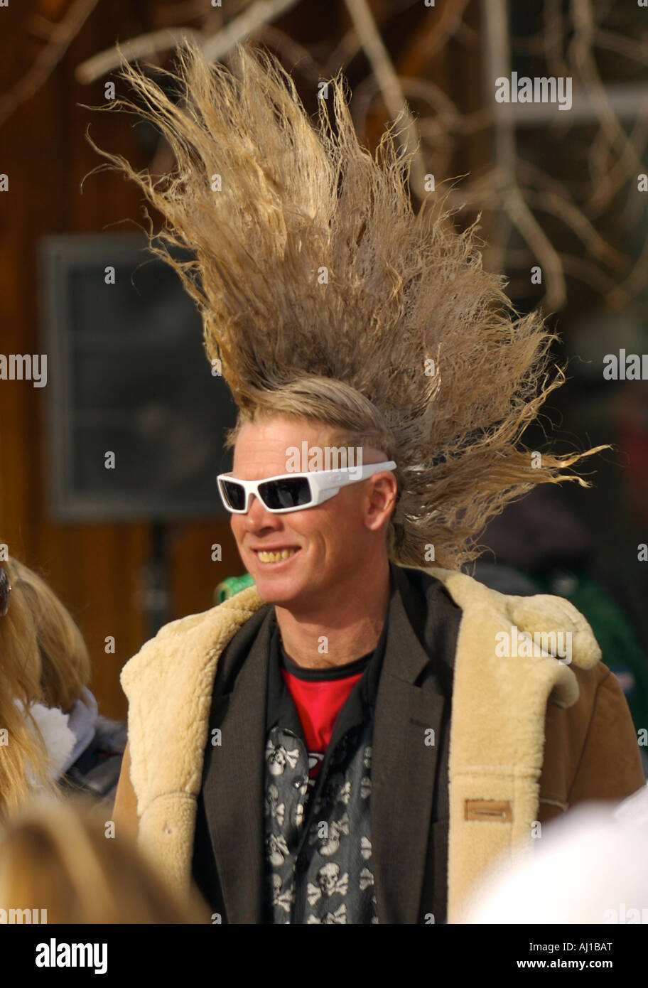 Smiling Man With A Mohawk Haircut And Sunglasses At The Espn Winter