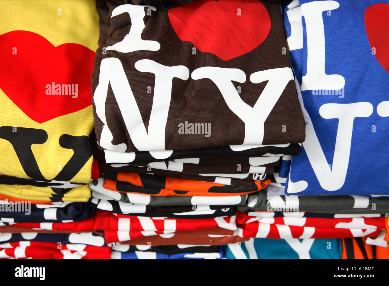 A colorful stack of I Love NY t-shirts - Stock Image