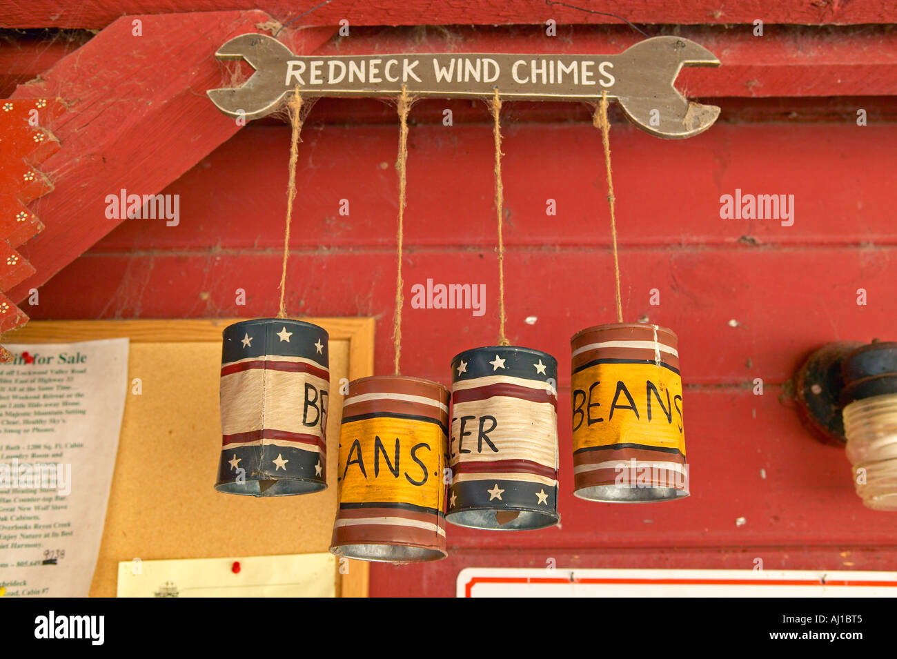 Kitschy wind chimes made of tin cans - Stock Image