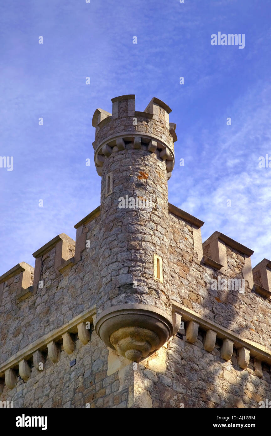 Turret from an English castle against a blue sky - Stock Image