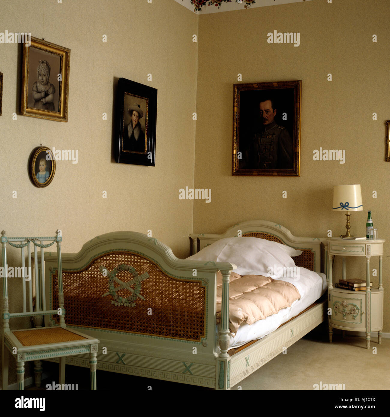 Bedroom With Antique Wooden Bed Featuring Woven Rattan Headboard In Stock Photo Alamy
