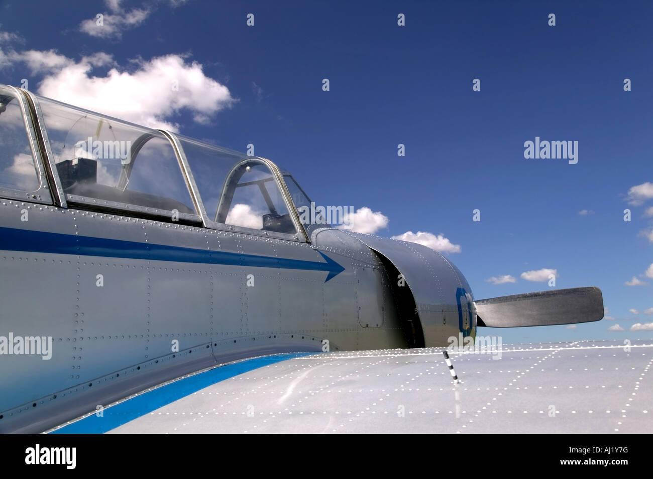 Old Russian fighter plane against a blue cloudy sky - Stock Image