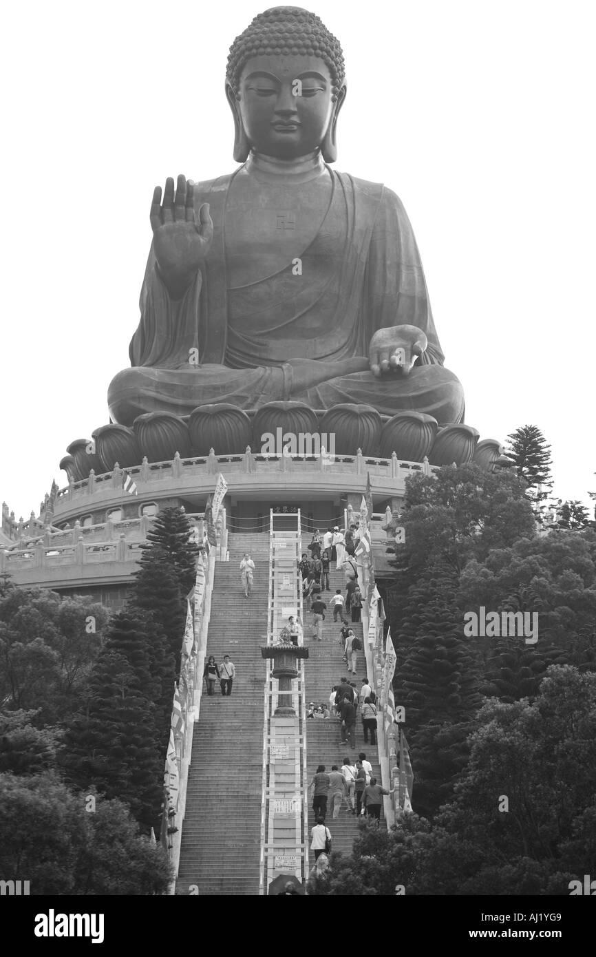 Asia Peoples Republic of China Hong Kong Visitors climb steps to Tian Tan Buddha Statue at Po Lin Monastery on Lantau Island - Stock Image