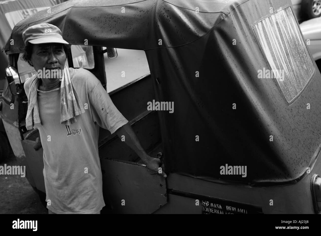 Indonesia Jakarta Portrait of motorcycle taxi drivers outside Kota Railway Station in downtown - Stock Image