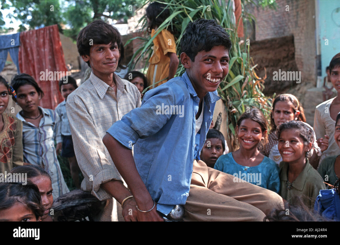 A crowd of happy inquisitive Indian youth from the village of Banroli near Agra India - Stock Image