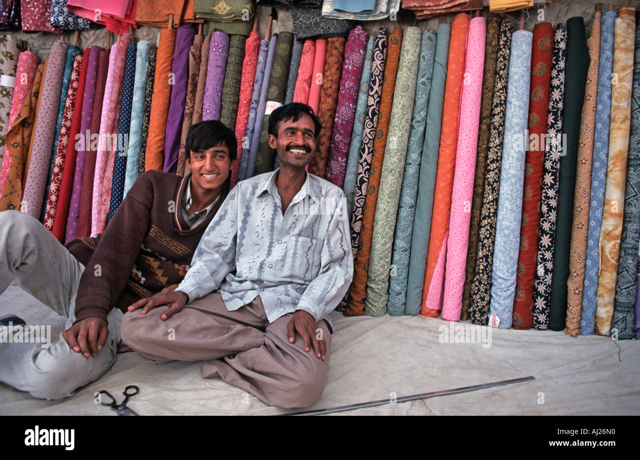 Fabric sellers at the Kashmiri market in Leh Ladakh Northern India - Stock Image