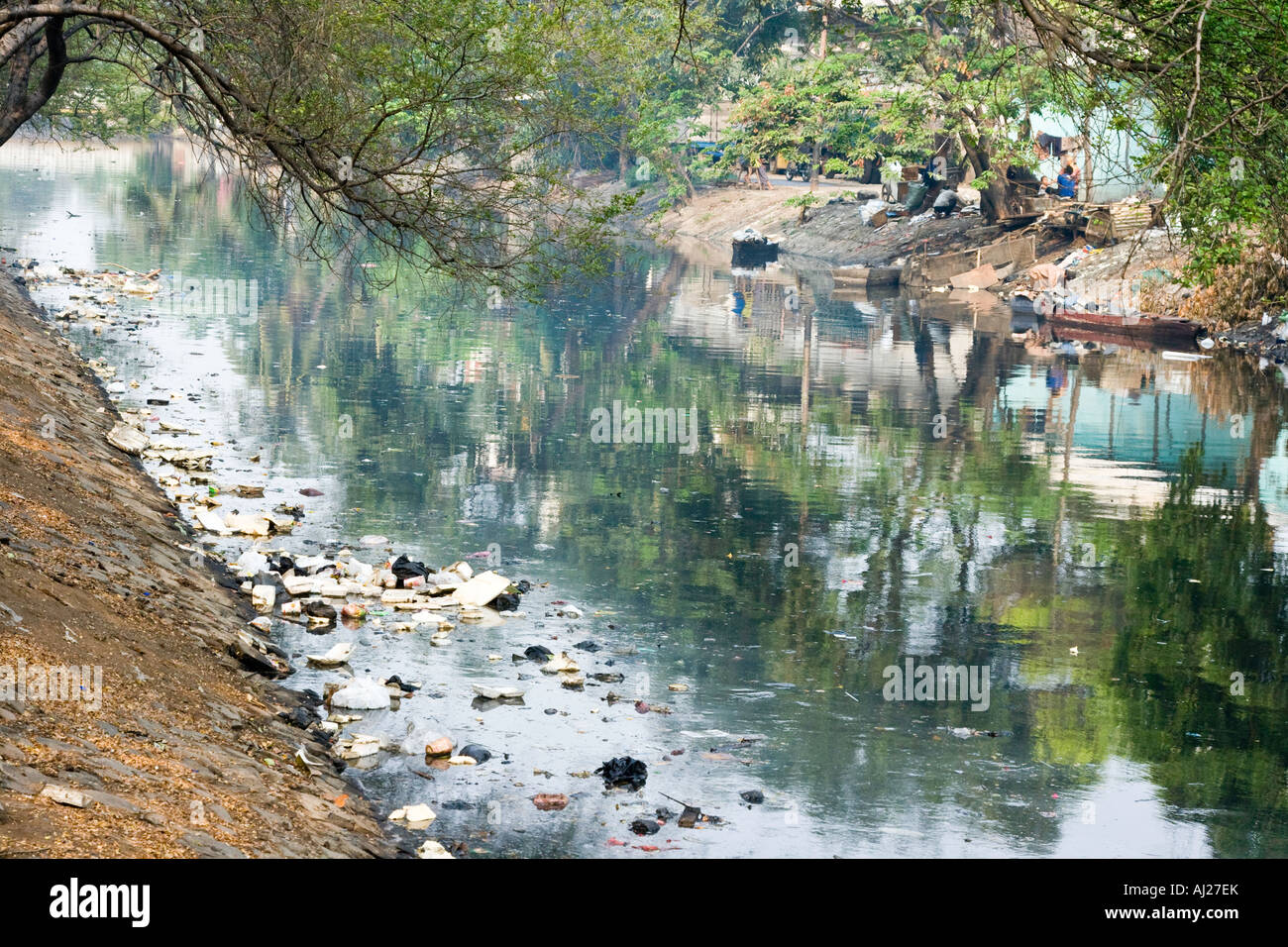 Polluted River Filled with Rubbish Jakarta Indonesia - Stock Image