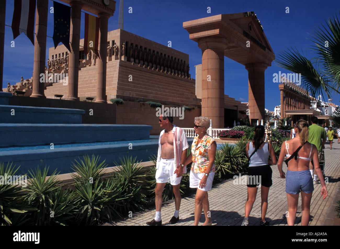 British holidaymakers outside hotel with Roman style pillars at ...