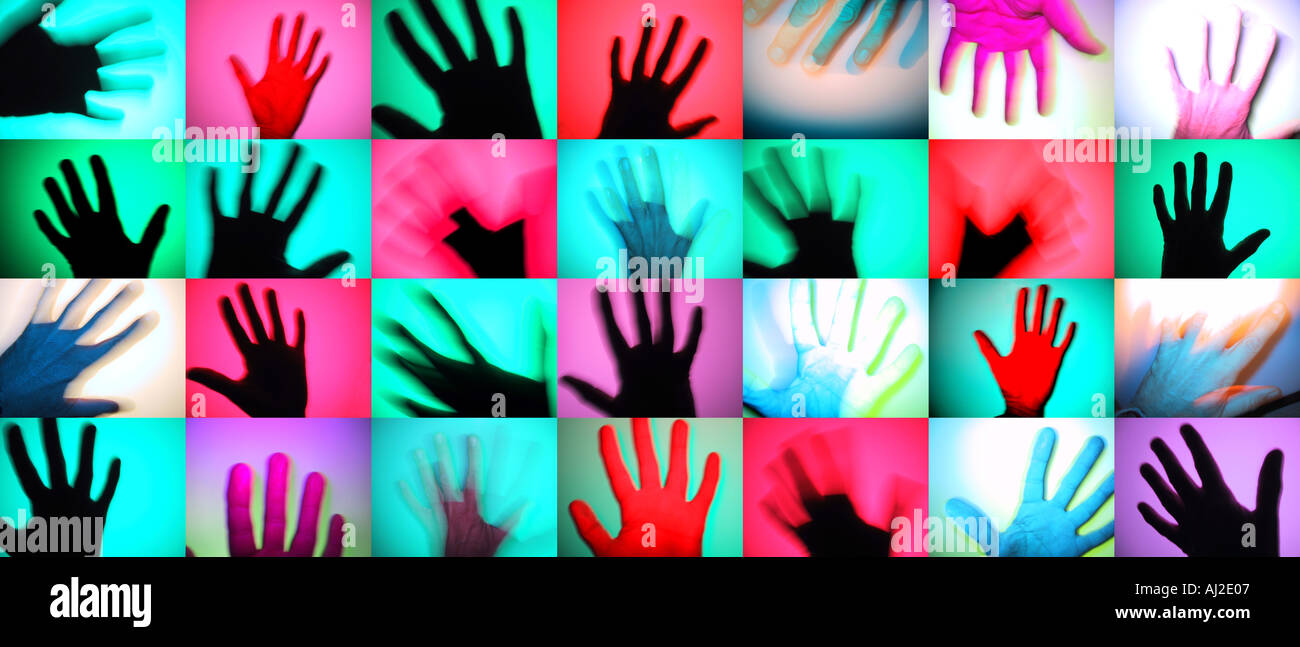 Rows of colourful hands. A modern photographic take on prehistoric rock art. - Stock Image