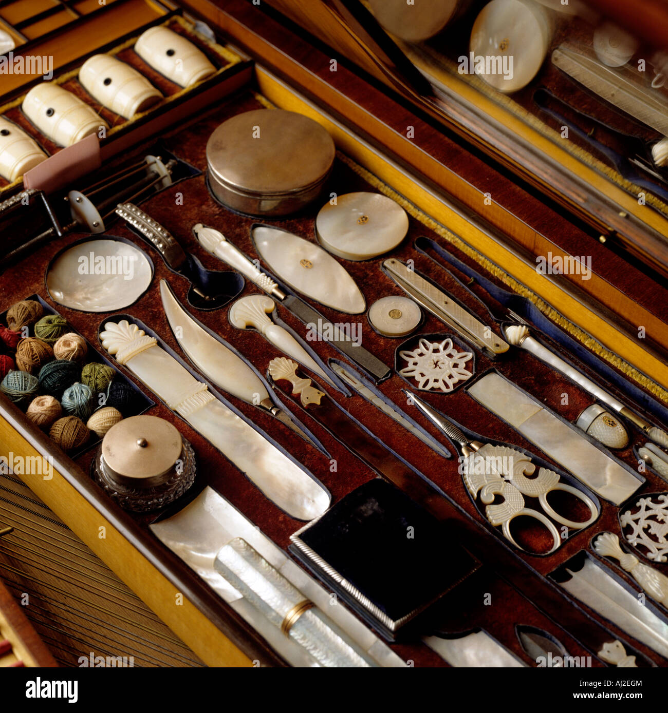 decorative display of antique pearl sewing equipment - Stock Image