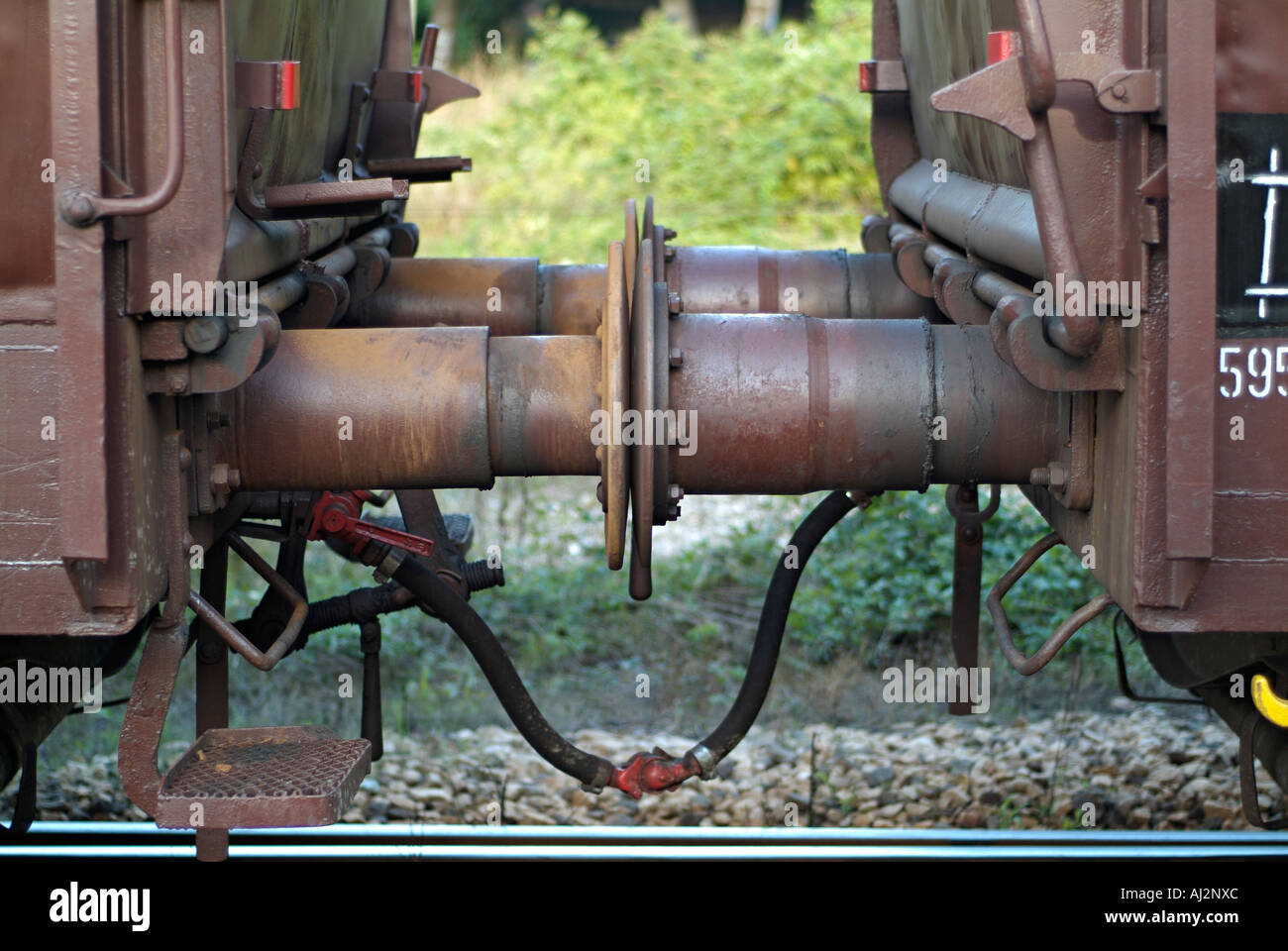 Close Up View of the Buffers of Two Connected Railway Freight Waggons - Stock Image