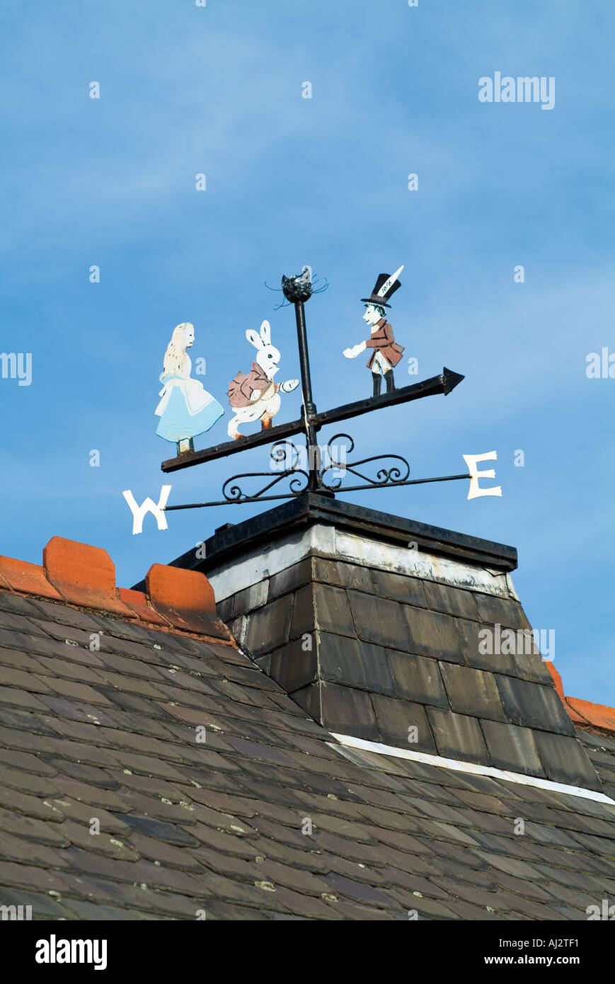 Alice in Wonderland windvane on top of the school in Daresbury Cheshire The village where Lewis Carroll lived - Stock Image