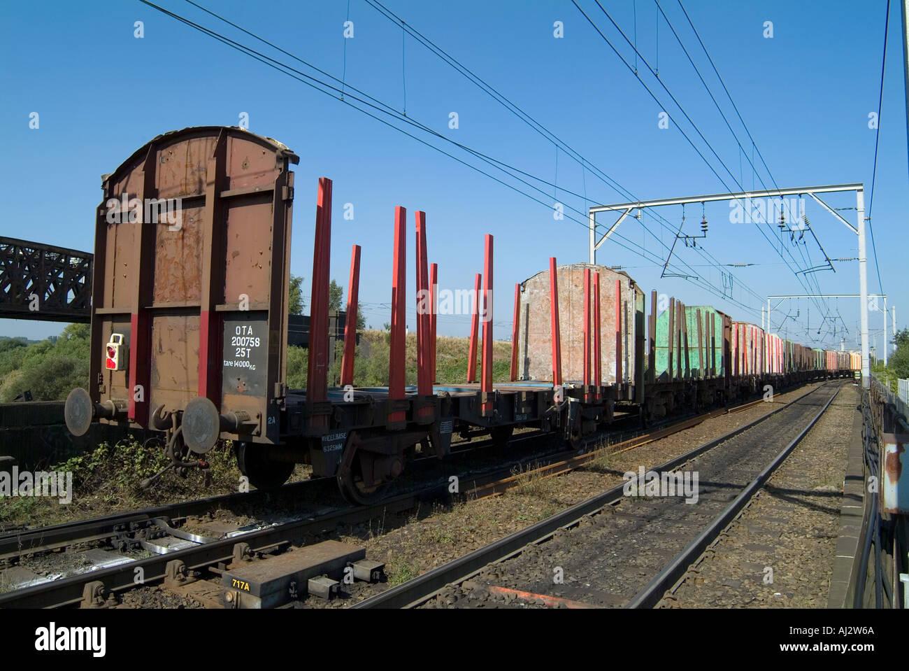 Unladen freight train on main west coast railway line in warrington england UK Stock Photo
