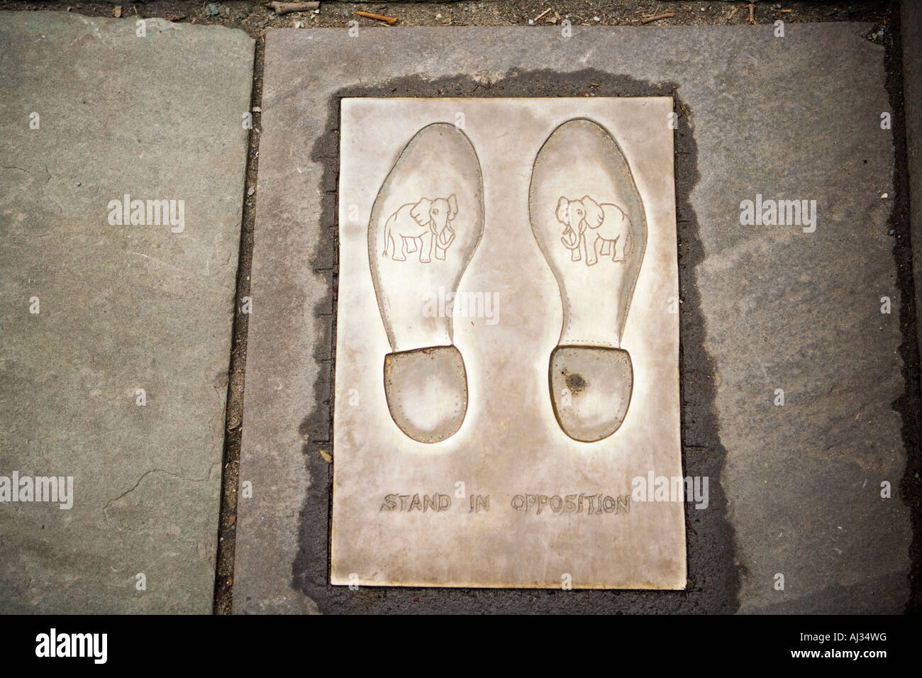 Stand In Opposition bronze footprints in front of the Democratic Party Donkey Old City Hall Boston Massachusetts - Stock Image