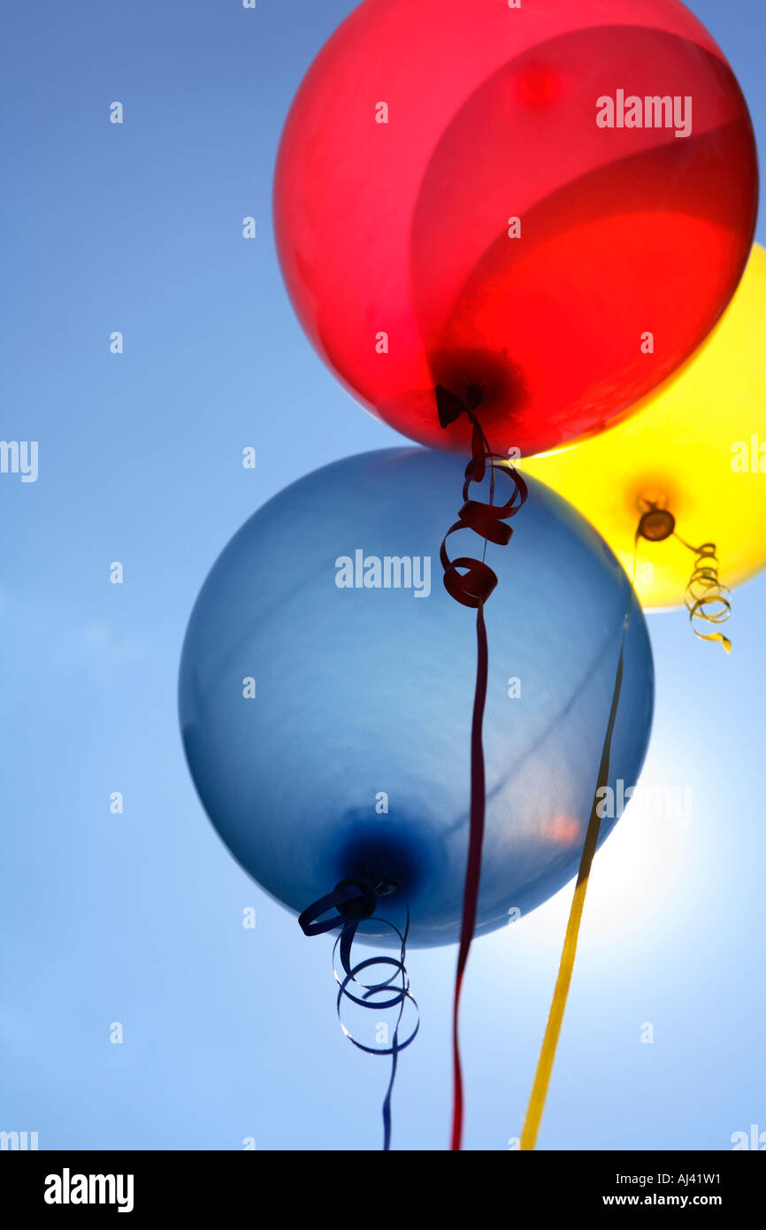 Balloons in the Sky with Sun Behind - Stock Image