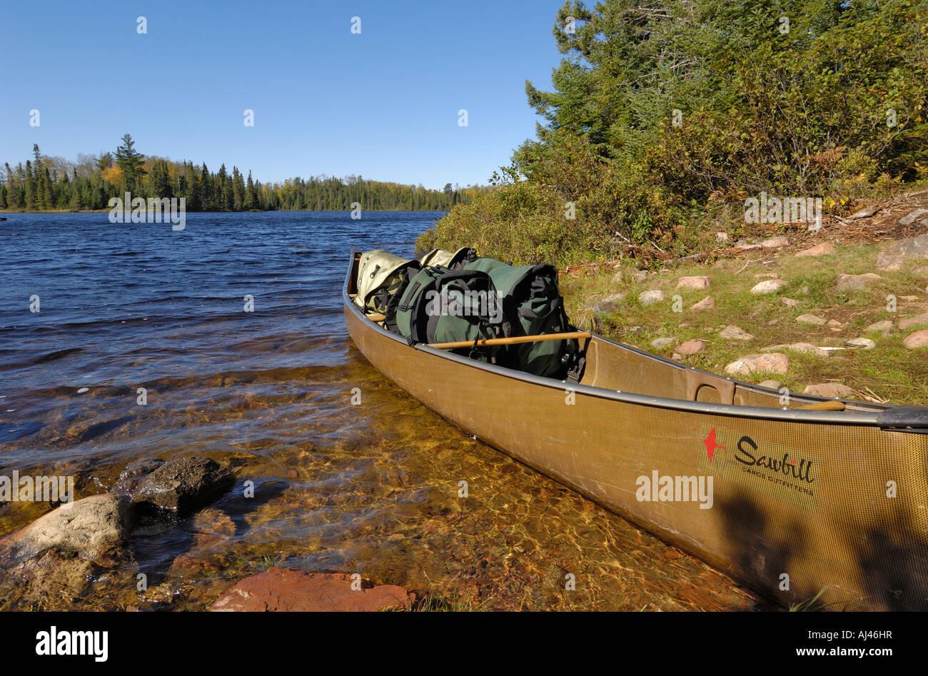 Canoe on Sitka Lake, Boundary Waters Canoe Area Wilderness, Superior National Forest, Minnesota, USA - Stock Image