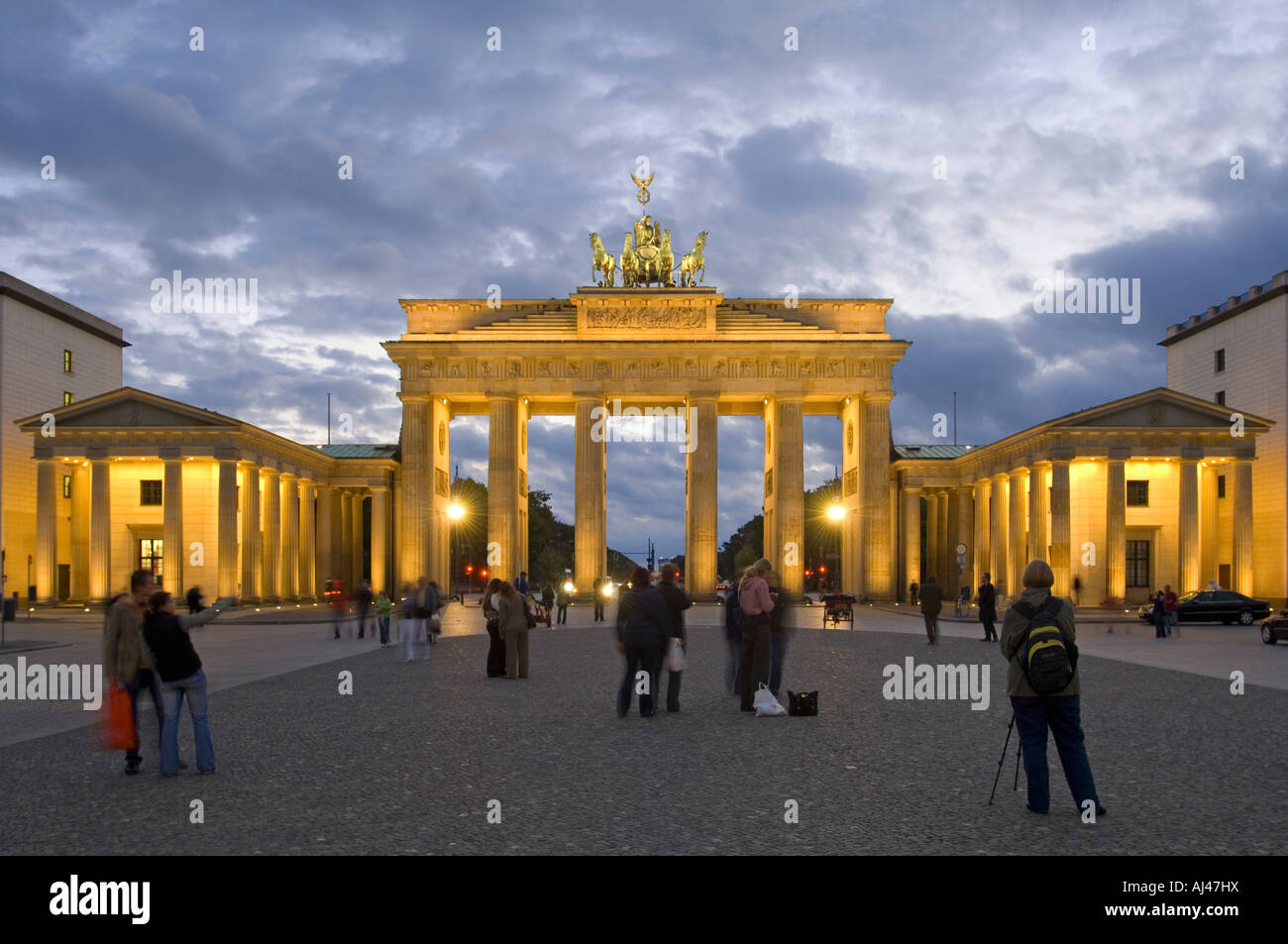 An HDR image of tourists at the Brandenburger Tor or Brandenburg Gate at sunset dusk. - Stock Image