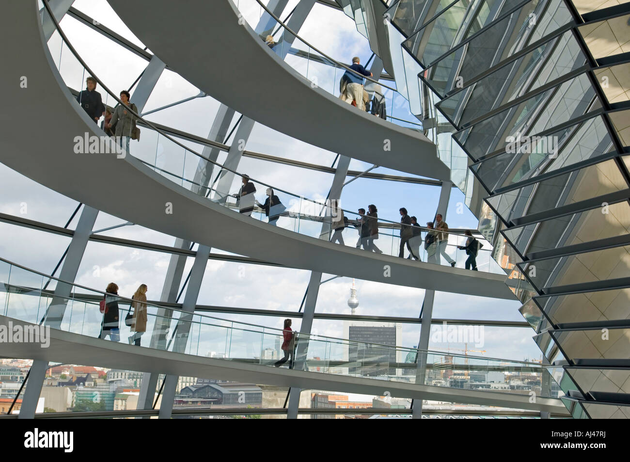 A wide angle view of tourists on the walkway inside the dome on top of the Reichstag - the german parliment building. - Stock Image