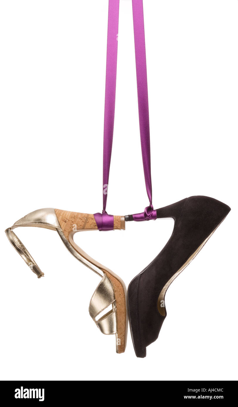 Ladies fashion shoes hanging on a ribbon Stock Photo