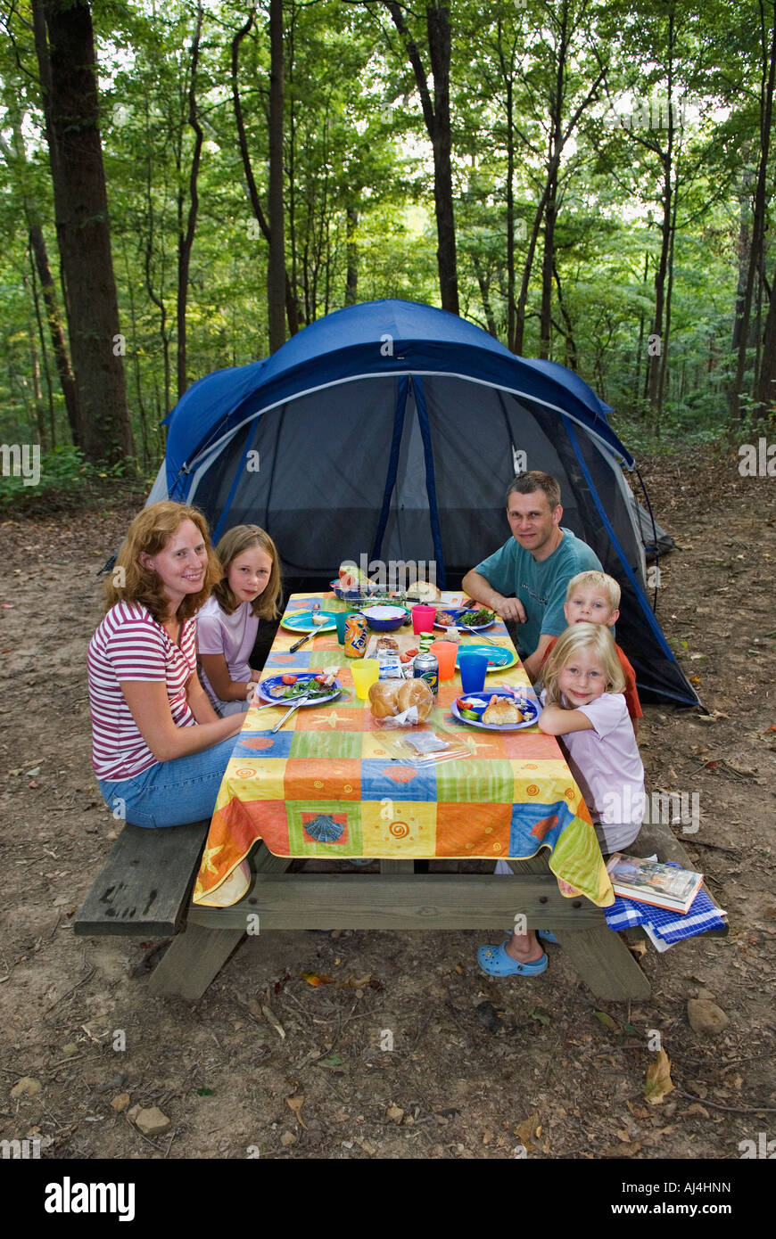Camping Family Eating Dinner At Picnic Table With Tent In The Background OBannon Woods State Park Indiana
