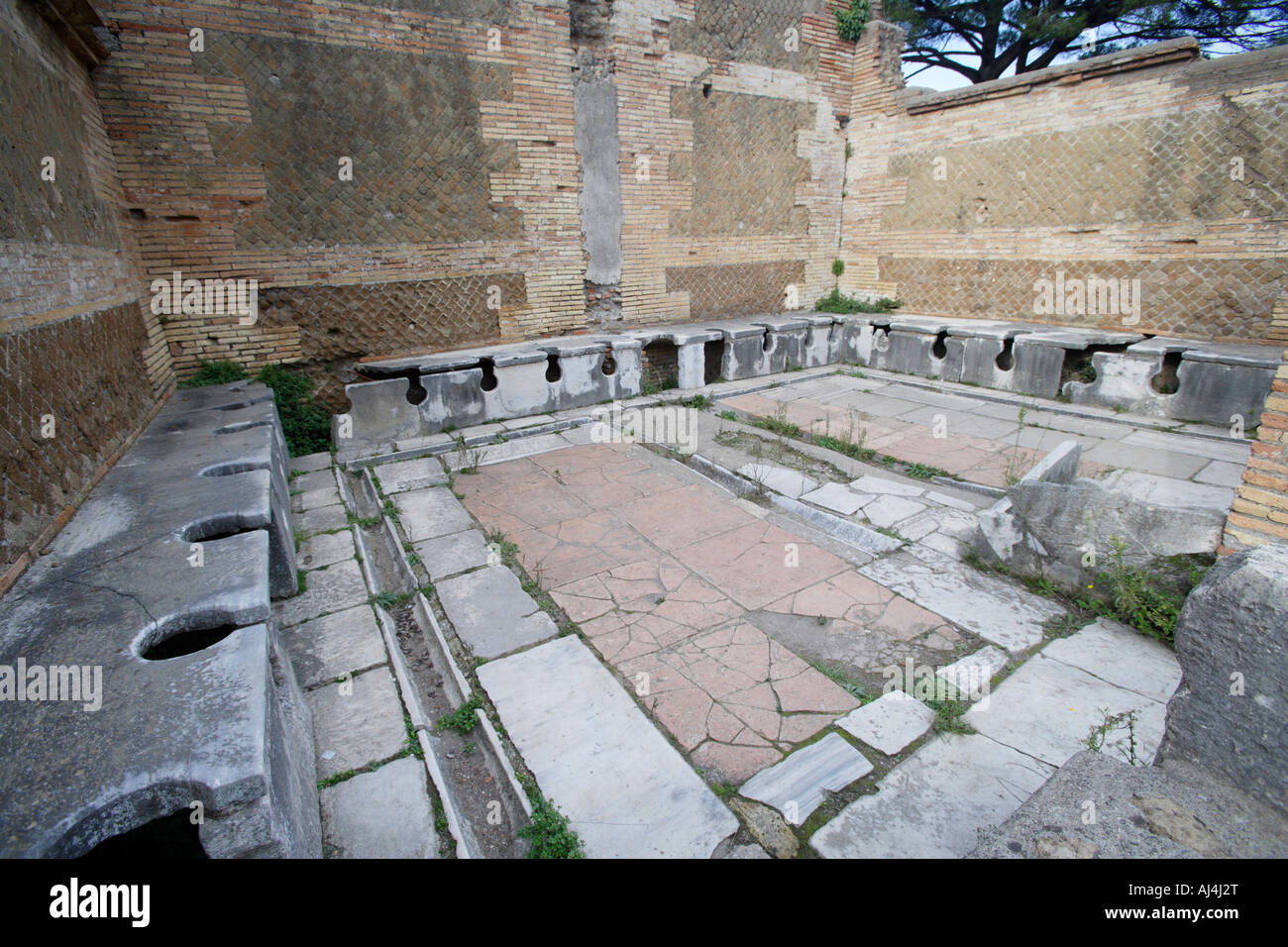 Public Latrines In The Ancient Roman Port Of Ostia Antica, Italy - Stock Image