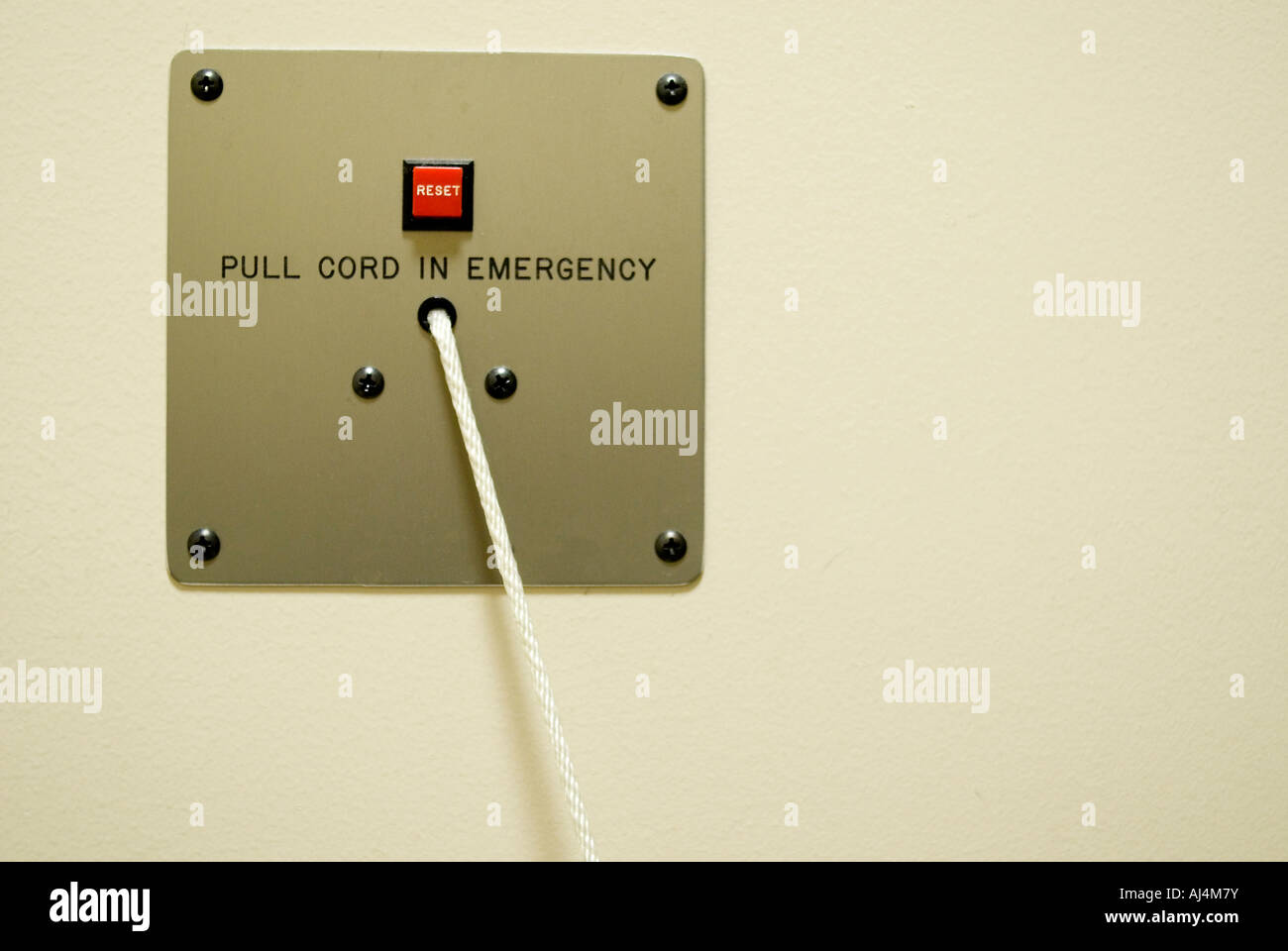emergency pull cord on wall in hospital Stock Photo: 14620574 - Alamy