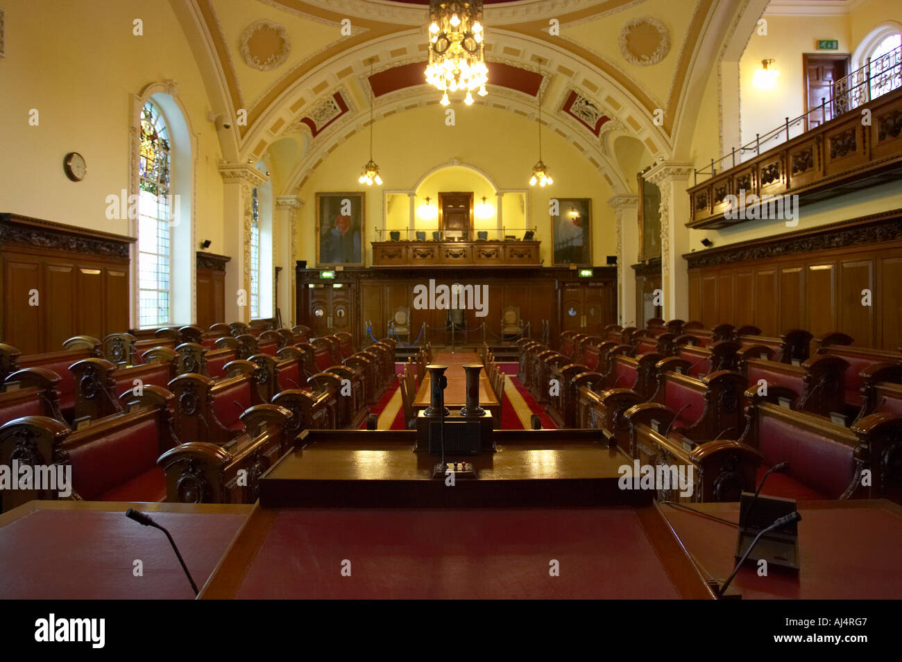 looking down along the council chamber from the lord mayors seat belfast city hall built in 1906 county antrim northern ireland - Stock Image