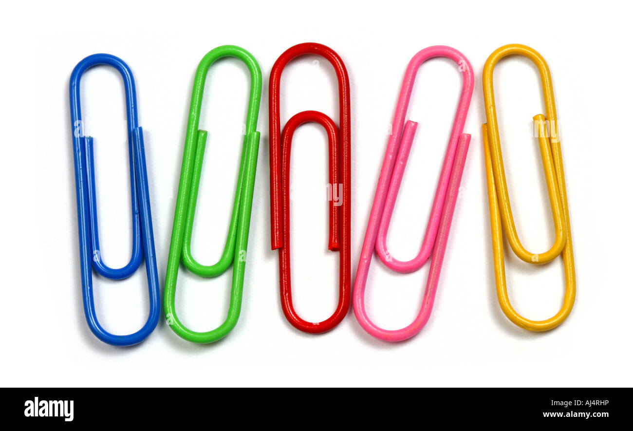 Colored clips over a white background - Stock Image