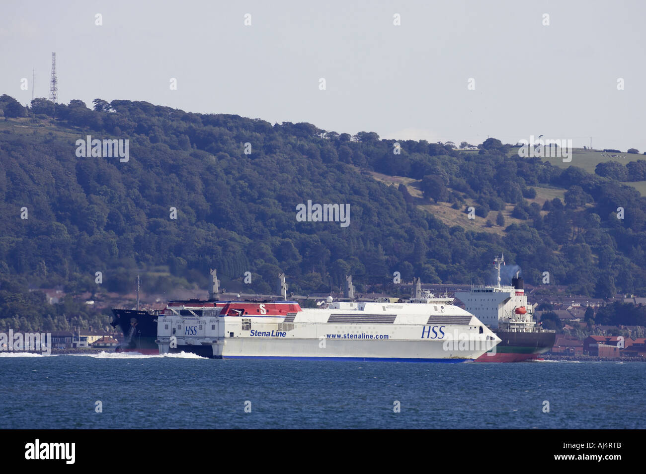 stenaline Stena Voyager HSS fast passenger ferry passes nord voyager bulk carrier ship hollywood belfast lough northern ireland - Stock Image