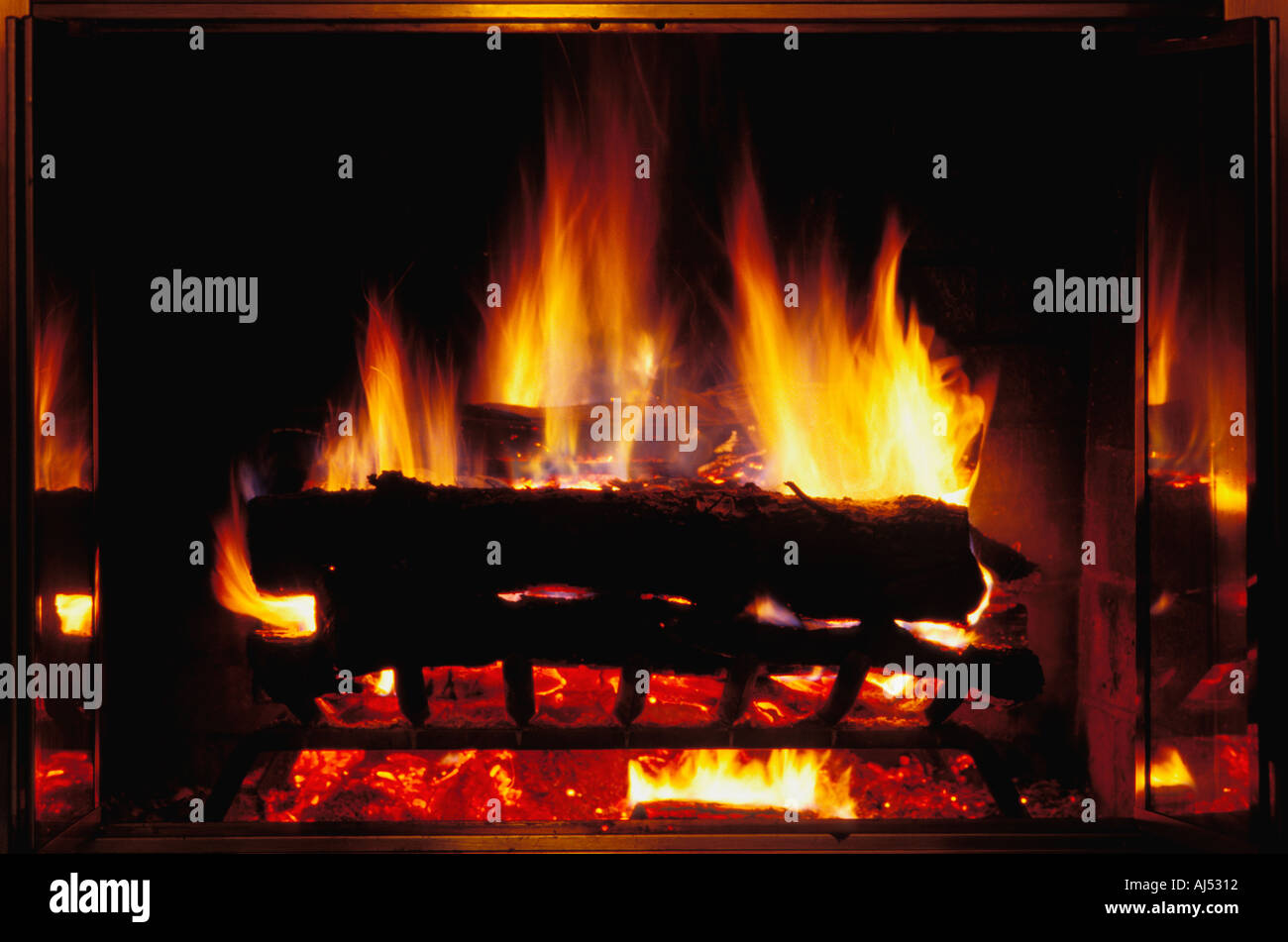 Cozy warm fire in a fireplace Stock Photo