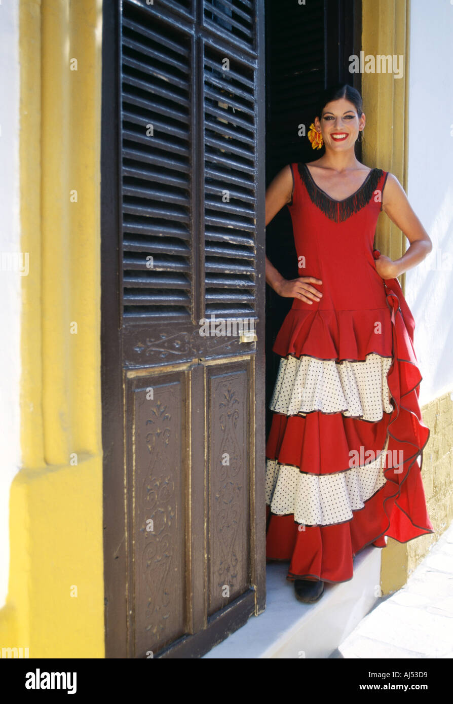bf3960e00534 Spain Andalucia Spanish girl in traditional flamenco dress or costume  standing in the doorway of her