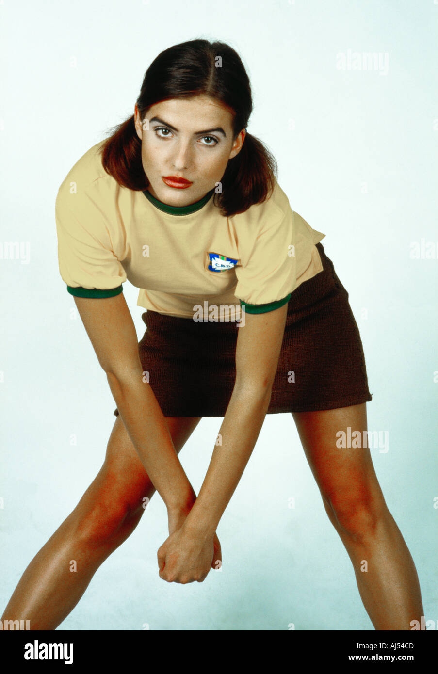 A young pretty girl in sporty dress poses for the camera - Stock Image