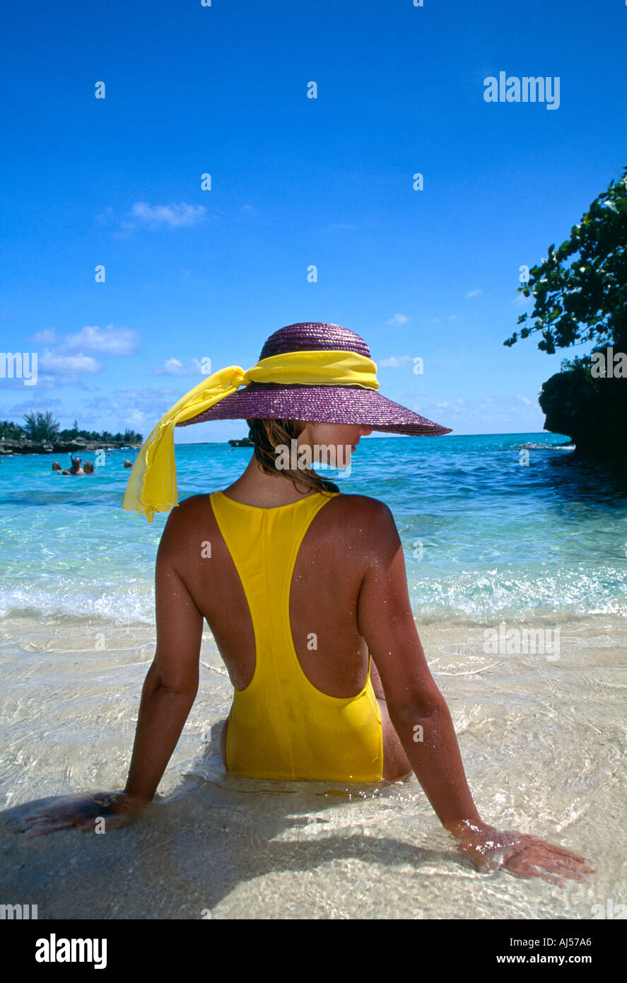 Woman in one piece bathing suit on beach Grand Cayman Cayman Islands - Stock Image