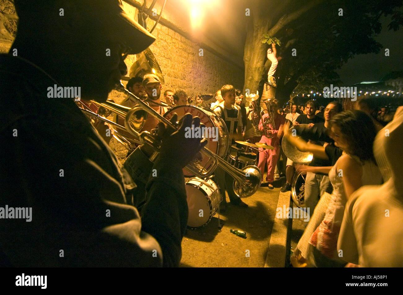 People playing music during the Fete de la Musique, a large public music festival, in Paris, France. - Stock Image
