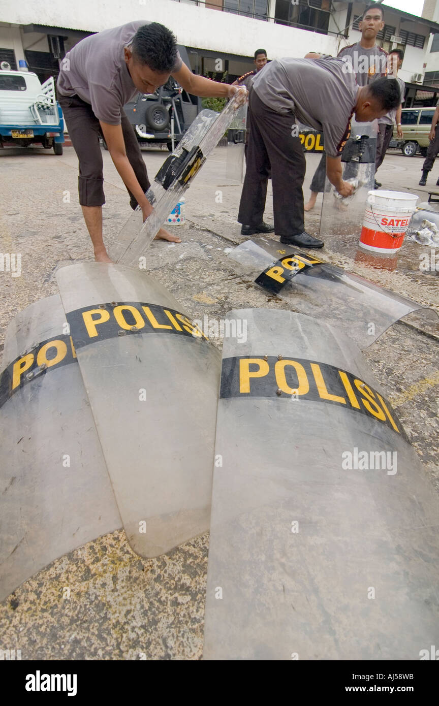 Indonesian police officers washing their anti-riot shields at their central compound in Jayapura, West Papua, Indonesia. Stock Photo