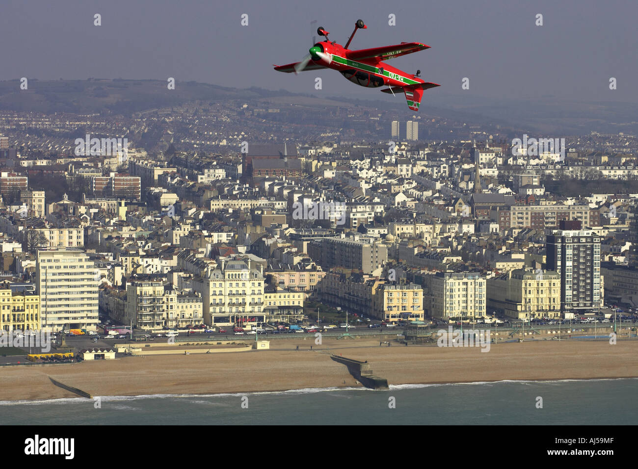suhkoi su 29 being flown by aerobatic ace alan cassidy over the sea of the coast of brighton england - Stock Image
