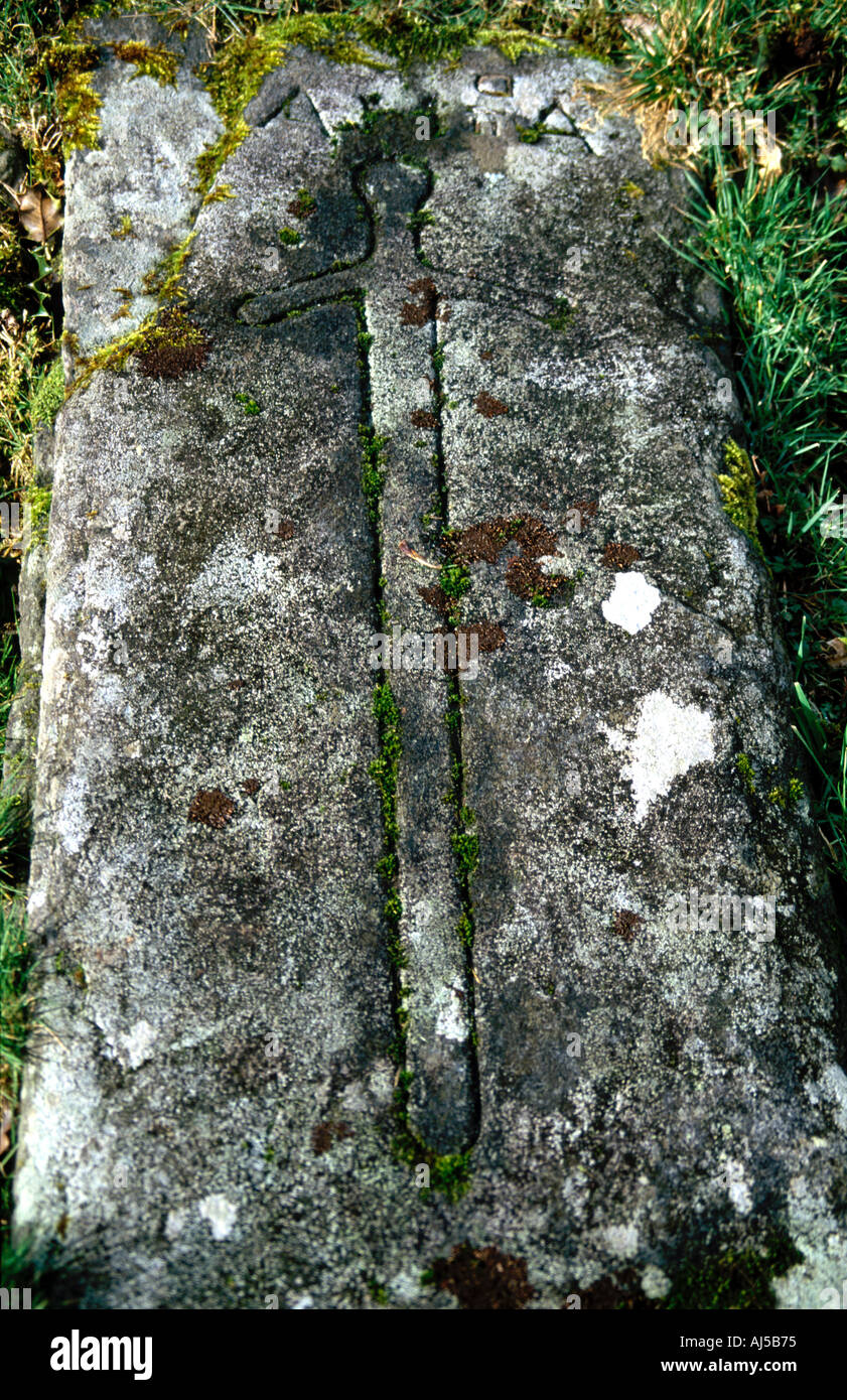 Carving of sword on tombstone Stock Photo