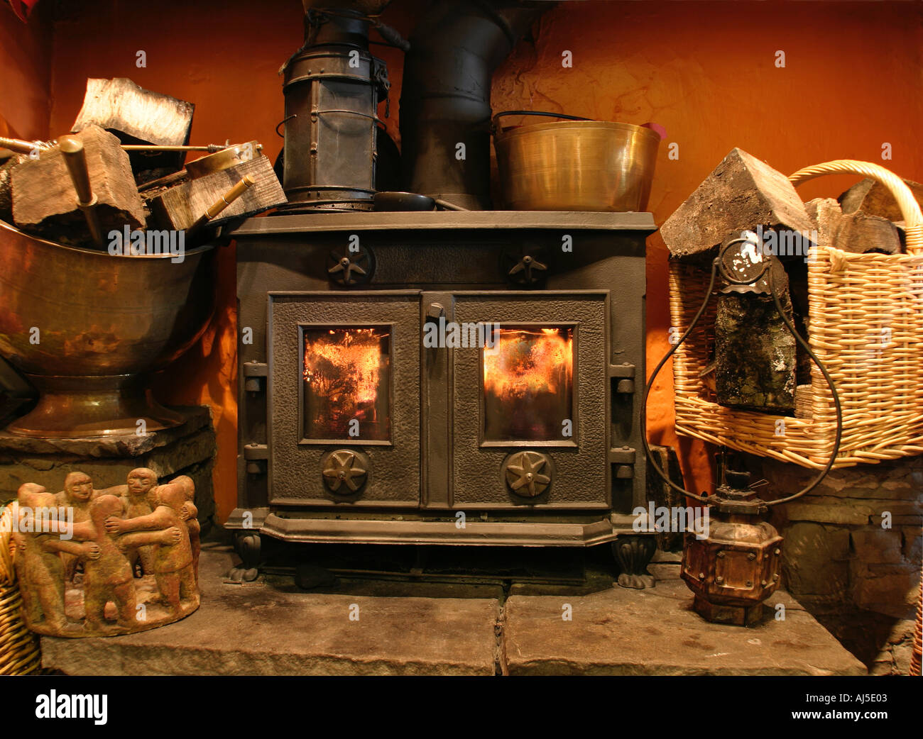 Welcome Home. Warmth and comfort with a wood burning stove - Stock Image