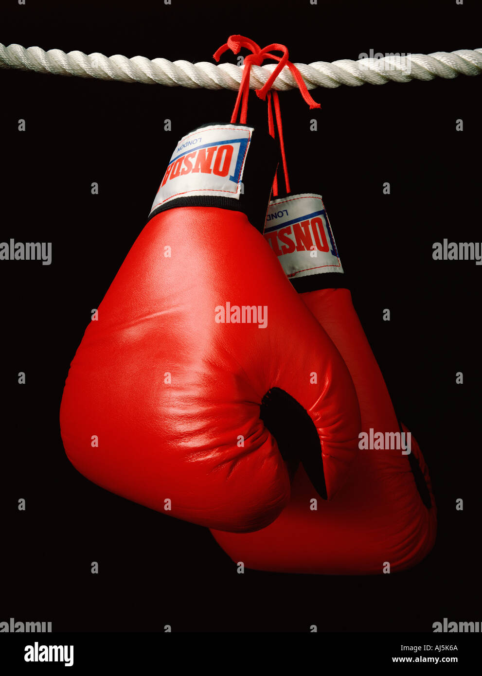 Boxing Gloves hanging on rope - Stock Image