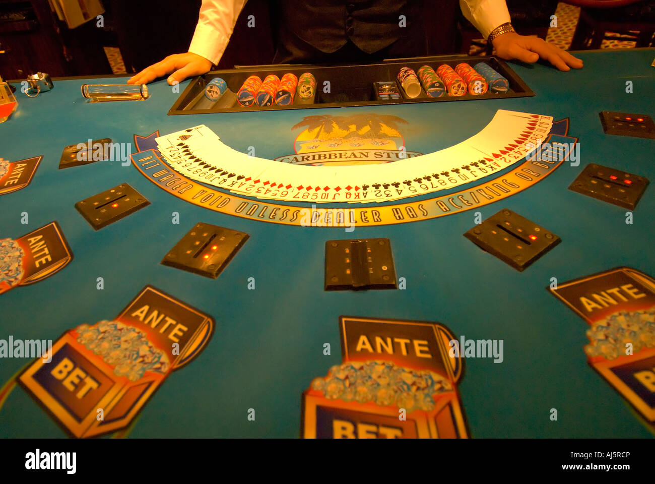 Casino Caribbean stud poker casino gambling game chance croupier dealer game game of chance gaming hands horizontal - Stock Image