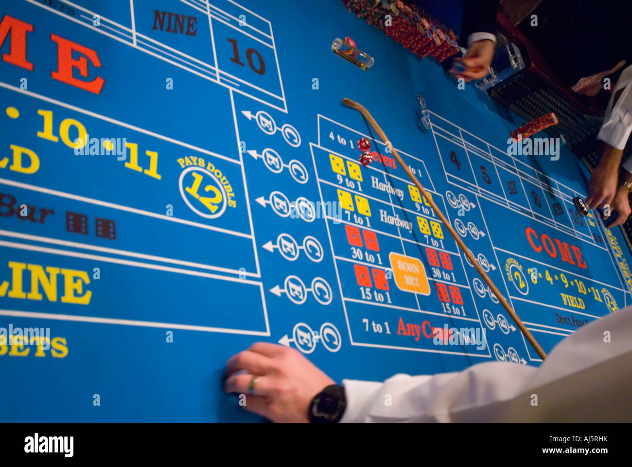 Gambling craps table action addiction addictive casino gambling game chance croupier dealer hands chips game game - Stock Image