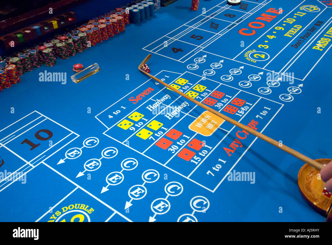 Gambling craps table action addiction addictive casino gambling game chance croupier dealer game game of chance - Stock Image